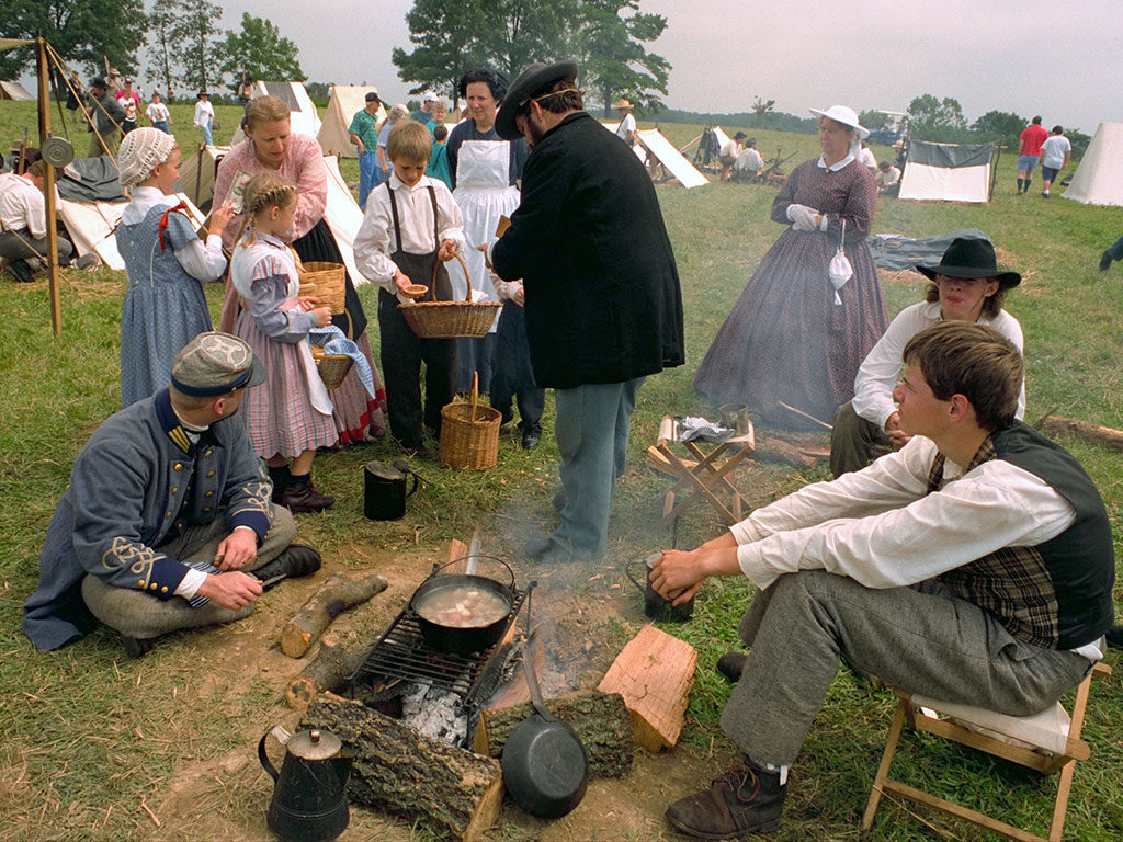 Reenactors in period clothing at a camp site on the Mill Springs Battlefield.