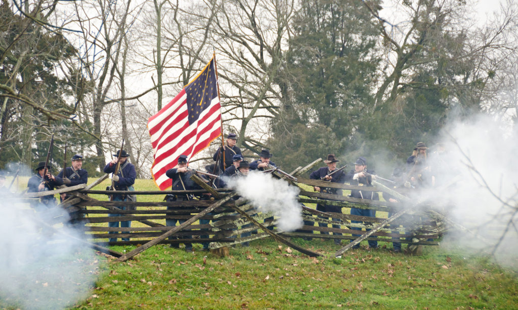 Union soldiers fire guns during reenactment
